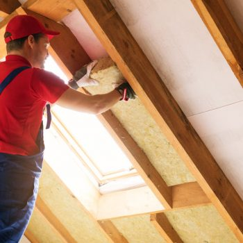 Man insulating the attic of a home